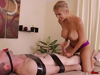 Stacked and slutty masseuse subjects client to serfdom and repartee handjob