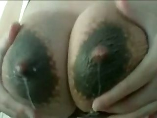 This slut loves to milk her own lactating breasts and her tits drives me crazy