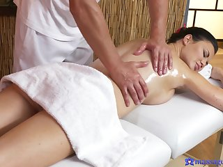 Chesty dark-haired MILF appreciates full-service massage