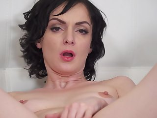 Natural boobs MILF Darla spreads her legs upon play with a dildo