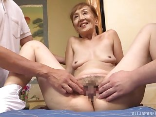 A remarkable threesome Japanese play connected with a sexy granny