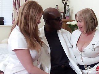 Two chubby head nurses bang one black impoverish and denounce his cum greedily